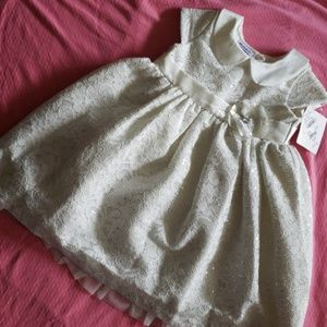 I'm selling a white toddler's dress